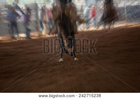Cowboy Riding Bucking Bronco Horse At Indoor Country Rodeo Showing Motion Speed