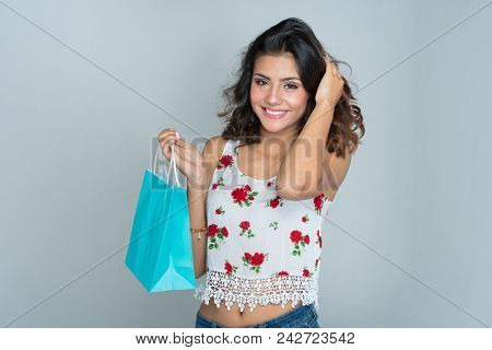 Hispanic teen girl modeling in a portrait session