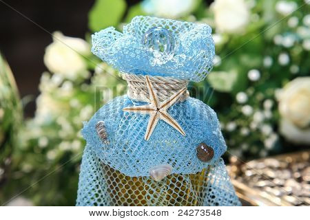 Bottle With Oil Decorated with Blue Veil And Sea Star