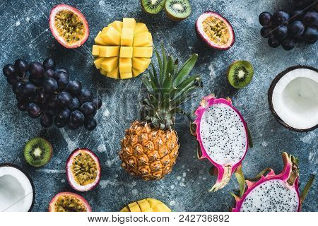 Tropical Fruits, Exotic Fruits On Concrete Background. Fruit Flat Lay. Dragonfruit, Passionfruit, Co