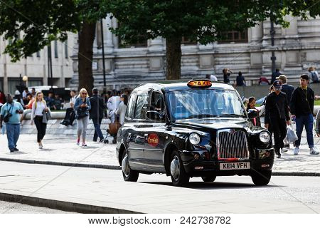 London, United Kingdom - July 31, 2017: Legendary London Taxi Cab And Red Bus On The Streets Of Lond