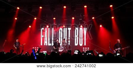 NEW YORK-DEC 8: (L-R) Musicians Joe Trohman, Patrick Stump, Andy Hurley and Pete Wentz of Fall Out Boy perform onstage at Pandora's Holiday Show at Pier 36 on December 10, 2015 in New York City.