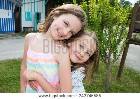 Two Sisters In Summer Hug And Love Family In Vacation Day