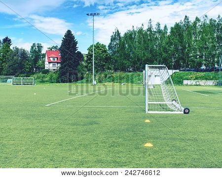 Football Playground. Gate With  Blue Yellow Nets, Soccer Football Net. Grass On Football Playground