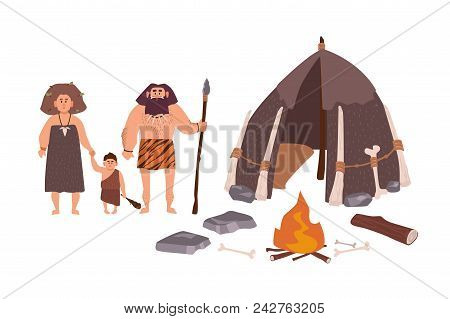 Family Of Ancient People, Cavemen, Primitive Men Or Archaic Human. Mother, Father And Son Standing B
