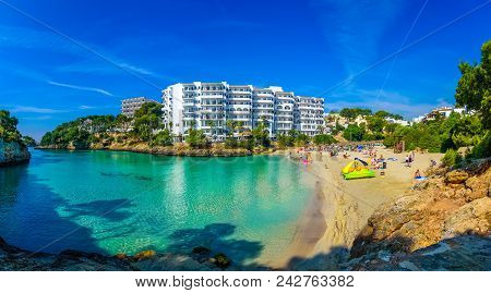 Panoramic View Of Cala Ferrera Beach With People On Seaside In Summer Holiday. Mallorca Island, Spai