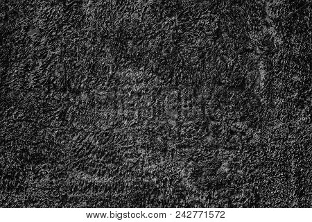 Cracked Black Textured Plaster Wall. Dark Abstract Background