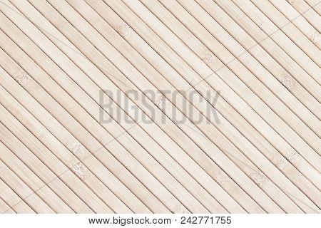 Light Bamboo Diagonal Slats Background. Natural Texture