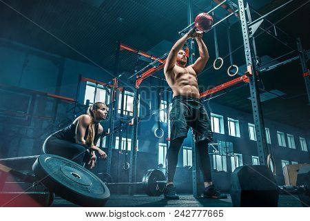 Fit Young Man Lifting Weight Working Out At A Gym. Sport, Fitness, Weightlifting, Bodybuilding, Trai