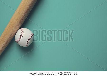 Baseball And Baseball Bat On Green Background, Close Up