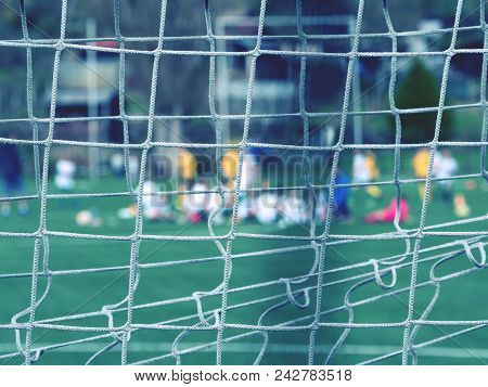 Hang Bended Soccer Nets Soccer Football Net. Grass On Football Playground In The Background