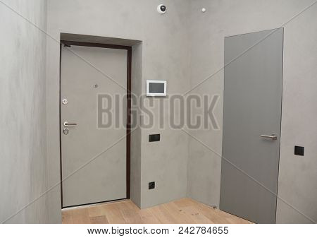 Modern House Entrance Metal Door Interior With Security  Cctv Camera Is Mounted On The Room Wall Wit