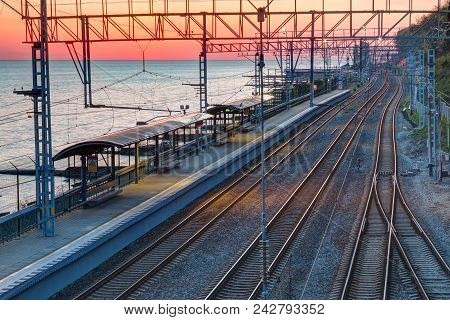 Aerial View Of The Railway Station On The Background Of The Sea At Sunset, Sochi, Russia