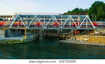 Drone Front View Of The Railway Bridge Over The Matsesta River With Motion Blurred Train In Summer D