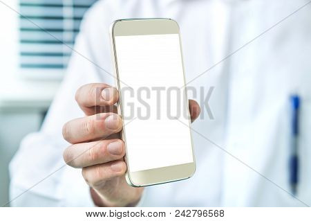 Doctor Holding Smartphone With Empty Blank White Screen. Medical Professional, Physician, Nurse Or D