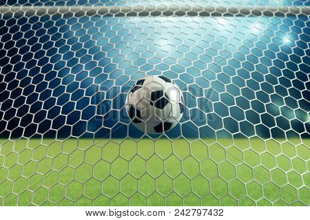 3d Rendering Soccer Ball In Goal. Soccer Ball In Net With Spotlight And Stadium Light Background, Su
