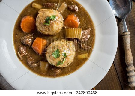 Stew With Venison And Bacon Onion Dumplings