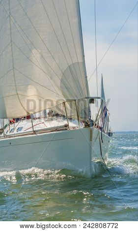 Close up of sailing boat, sail boat or yacht at sea with white sails