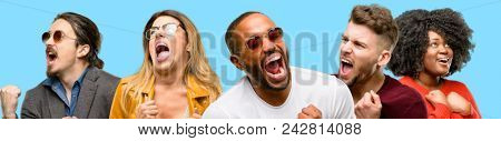 Group of mixed people, women and men happy and excited celebrating victory expressing big success, power, energy and positive emotions. Celebrates new job joyful