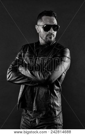 Confident Macho Stand With Arms Folded. Bearded Man In Trendy Sunglasses. Fashion Man In Leather Jac