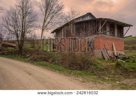 Old Abandoned Barn In A Large Field With Cloudy Sky At Mudurnu Mountains, Turkey