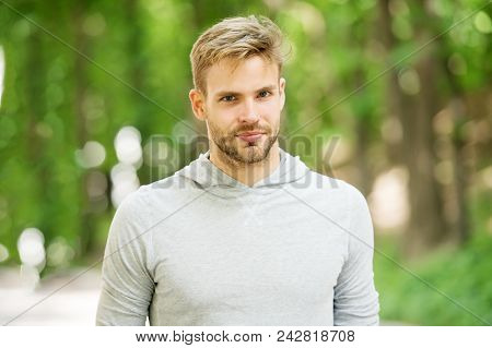 Man With Bristle On Calm Face, Nature Background, Defocused. Skin Care Concept. Man With Beard Or Un