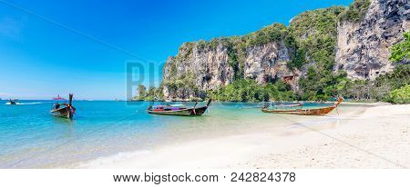 Amazing Landscape With Traditional Longtail Boats, Rocks, Cliffs, Beautiful Sea Tropical And White T