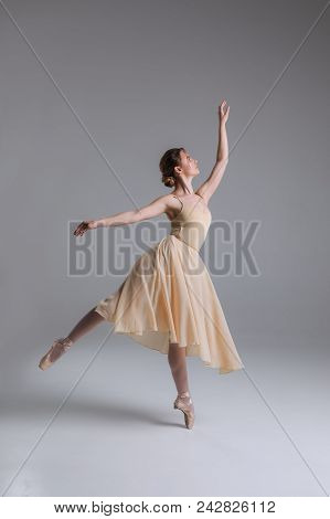 Let Yourself Become Free! Pretty Good-looking Charming Professional Ballerina In The Beige Dress Mak
