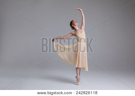 Timeless Interpretation Of Life! Full Length Photo Of The Young Beautiful Ballerina Fulfilling Movem