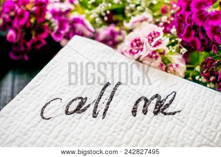 The Inscription Call Me On A White Napkin Left On The Table In A Cafe. Text Call Me On A Background