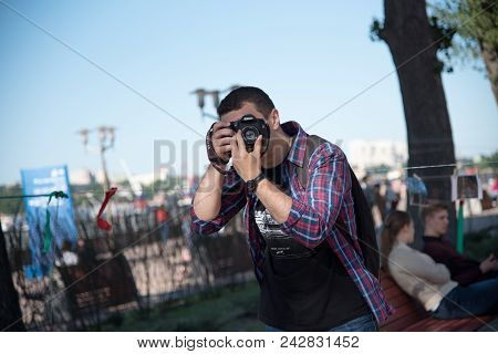 May 27, 2008. Russia. Rostov-on-don. Reporter At An Open Event. Street Show Of Photos Of Professiona