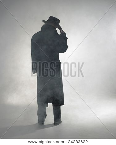 Woman Wearing Trench Coat And Standing In Fo