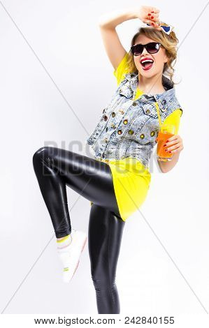 Happy Youth Lifestyle Concepts. Funny And Upbeat Caucasian Blond Girl With Orange Juice And Straw. W