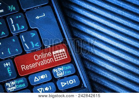Computer Keyboard With Red Button Online Booking Concept