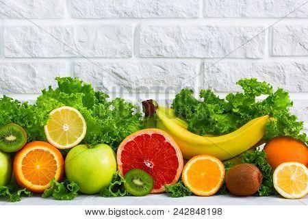 Healthy Food Fruits Grapefruit, Lemon, Kiwi, Apple, Banana, Orange, Green    Salad Background On Whi