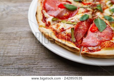 Pizza With Salami And Gherkins, Close Up, Copy Space. Delicious Italian Cuisine, Family Restaurant,
