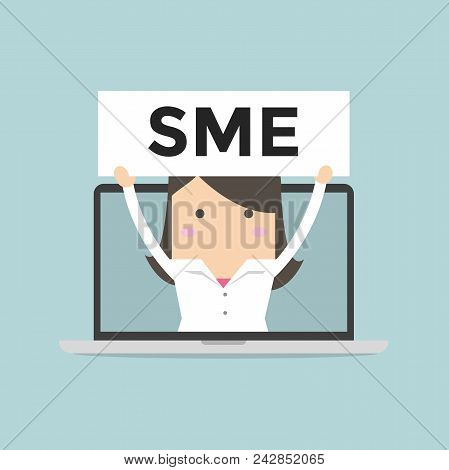 Businesswoman Holding Sme Sign In Computer Notebook