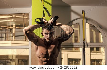Mens Heals Body Care. Sportsman, Athlete, Muscular Macho Does Exercise With Trx Loops, Window On Bac