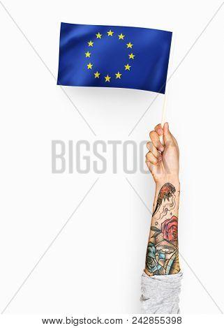Person waving the flag of European Union