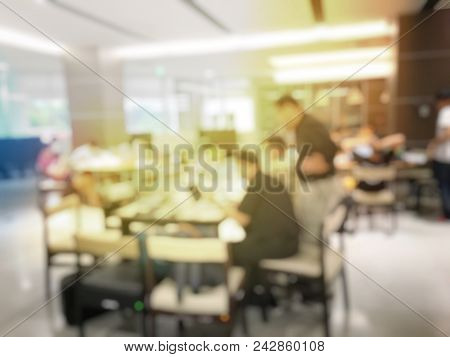Blurred Image Of Teamwork People Concept.young Team Of Coworkers Making Great Business Discussion In