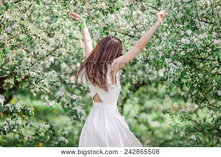 Spring Mood, Beautiful Woman Smell Flowering Tree, Enjoying Nature, White Floral Garden. Beautiful W