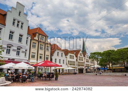 Lingen, Germany - June 4, 2016: People Sitting Outside At A Restaurant In Lingen, Germany