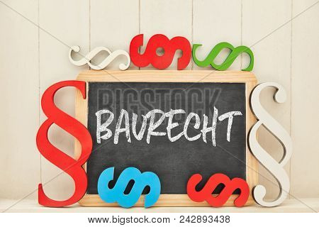 German word Baurecht (construction law) as concept with many colorful law symbols around a blackboard