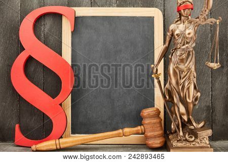 Blank blackboard background Justitia as law and law concept