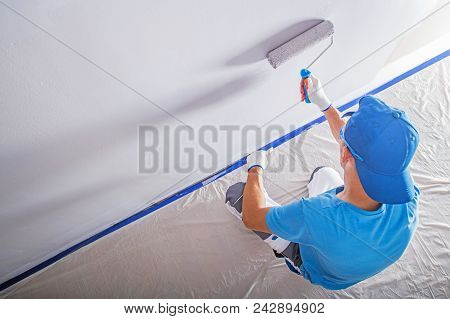 Apartment Remodeling And Painting By Caucasian Construction Worker.