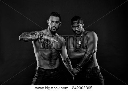 Fashion Models With Tattoo In Jeans. Men With Fit Tattooed Bodies. African And Hispanic Men With Sex