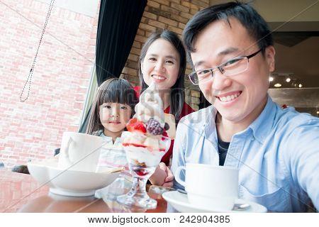 Family Selfie Adn Smile Happily In Restaurant