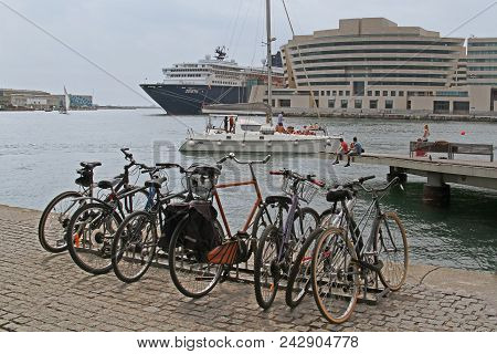 Barcelona, Spain - September 14, 2014: City Bicycles Stand In A Row On A Parking On The Waterfront A