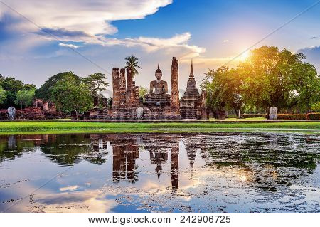 Buddha Statue And Wat Mahathat Temple In The Precinct Of Sukhothai Historical Park, Wat Mahathat Tem
