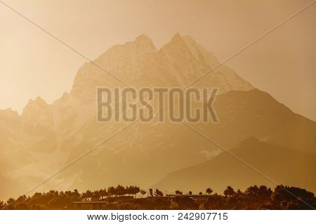 The misty Thamserku Mountain in the Namche Bazaar Region. The Himalayas. Eastern Nepal. Ideal background in beige, bright brown tints for the illustrations and collages.